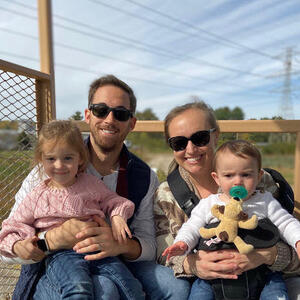Erin Abbott with family at an outdoor sporting event