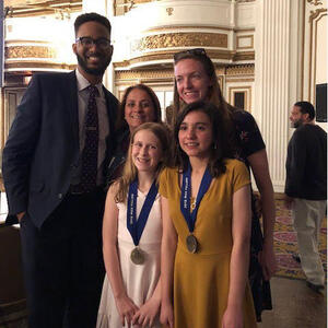 Sarah Zrike with students receiving awards
