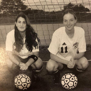 photo of nbspRebecca Poswolsky and Helen Sullivan posing with soccer balls